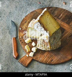 Cheese assortment on board, close-up, vertical composition - Stock Photo