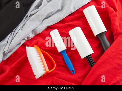 A lint brush used to remove excess fabric and particles from cloth - Stock Photo