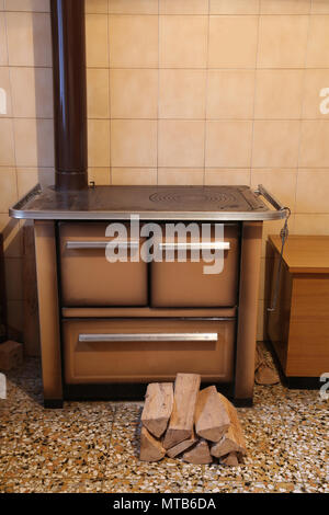 old wood burning stove in the kitchen of an home - Stock Photo