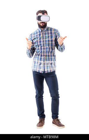 Young smart casual business man with virtual reality glasses showing thumbs up gesture. Full body isolated on white background. - Stock Photo
