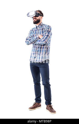 Bearded adult business man watching virtual reality glasses with crossed arms. Full body isolated on white background. - Stock Photo