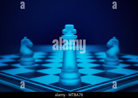 Chess game. King on the battle field with two knights. - Stock Photo