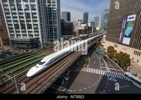 Japanese high-speed train Shinkansen on bridge in central Tokyo. - Stock Photo