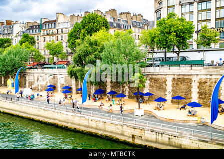 The Paris Plages are temporary artificial beaches each summer along the river Seine in the centre of Paris - Stock Photo