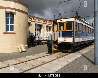 Snaefell Mountain Railway at Summit Station next to Summit Hotel the highest point on  Isle of Man ticket collector speaking to passenger - Stock Photo