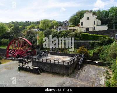 Looking down on Valley gardens with ruins of lead ore washing rooms and replica mine water pump wheel Laxey Isle of Man part of old mine complex - Stock Photo
