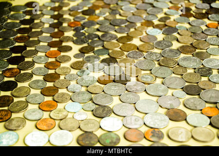 Collection of colorful coins of world - Stock Photo