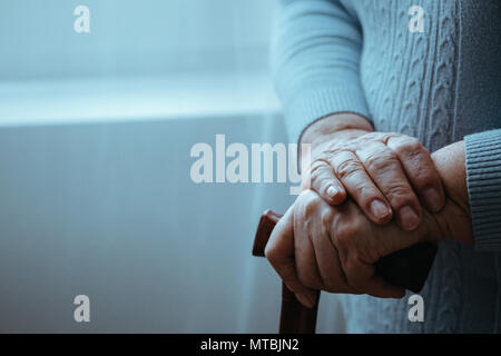 Disabled, senior person with walking stick, close up - Stock Photo