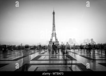 Blurred people on Trocadero square admiring the Eiffel tower, Paris, France - Stock Photo