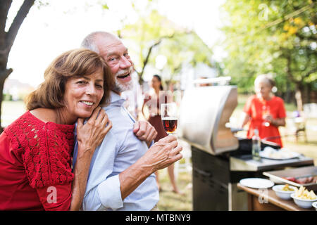Family celebration or a barbecue party outside in the backyard. - Stock Photo