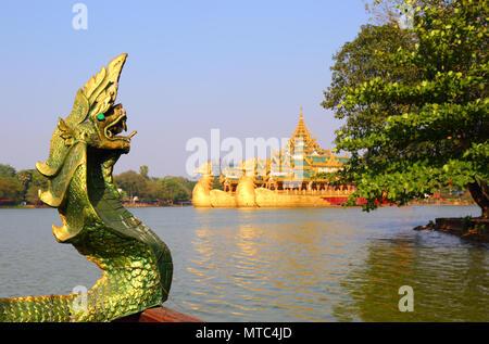 Head of snake Karaweik in Yangon - Stock Photo