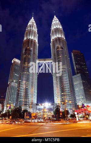 Petronas Twin Towers at night in Kuala Lumpur - Stock Photo