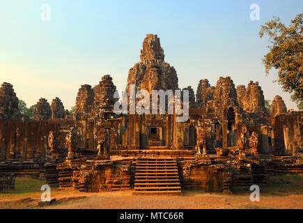 Bayon Temple at sunset in Cambodia - Stock Photo