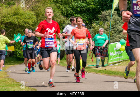 Gosford Estate, East Lothian, Scotland, UK. 28th May 2017. Marathon runners in Edinburgh Marathon at Mile 18 with fat man in kilt - Stock Photo