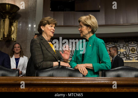 Senators Jeanne Shaheen (D-NH)(left) and Elizabeth Warren (D-MA) converse prior to a Senate Armed Services Committee meeting at the U.S. Capitol on May 18th, 2017. - Stock Photo