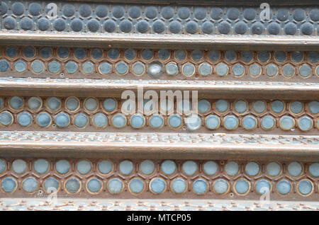 Closeup of iron steps with glass vault lights on an old industrial building in NYC's historic Soho district - Stock Photo