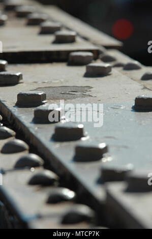 Closeup of rivets on a steel beam on the iconic Brooklyn Bridge - Stock Photo
