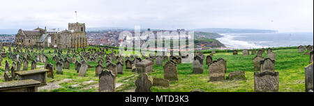 Panoramic view of Whitby from Whitby Abbey with graveyard and St Mary's Church in foreground taken in Whitby, Yorkshire, UK on 22 May 2018 - Stock Photo