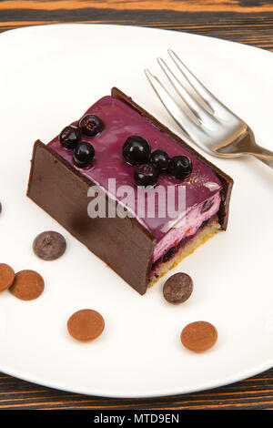 Cheesecake with fresh blueberries on white plate. Blueberry cheesecake. - Stock Photo