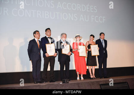 Paris, Li fangfang (3rd R). 28th May, 2018. Chinese actor Liu Ye (2nd L), film director Li fangfang (3rd R), French actress Virginie Ledoyen (2nd R) and festival's ambassador Costa Gavras (3rd L) receive their awards on the 8th edition of Chinese Film Festival in France (FCCF) on May 28, 2018. The film festival runs from May 28 to July 10 in Paris and in several French cities including Cannes, Marseille, Lyon, Saint-Denis Reunion, Strasbourg and Brest, offering French audiences a chance to discover nine Chinese films released last year. Credit: Zhang Man/Xinhua/Alamy Live News - Stock Photo
