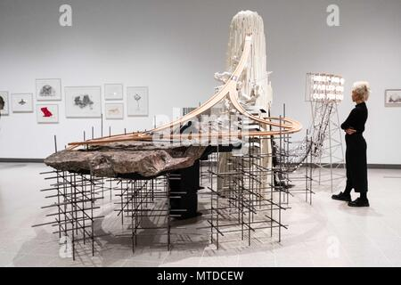 London, UK. 29th May, 2018. A gallery associate views an art installation titled Weep into Stones by South Korean artist Lee Bul at the Hayward Gallery in London, Britain on May 29, 2018. Credit: Ray Tang/Xinhua/Alamy Live News - Stock Photo