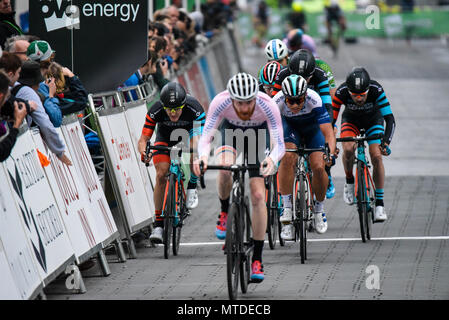 Riders racing in the elite men's 2018 OVO Energy Tour Series cycle race at Wembley, London, UK. Round 7 bike race. - Stock Photo