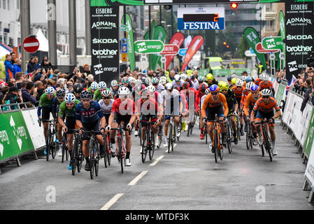 Riders racing in the elite men's 2018 OVO Energy Tour Series cycle race at Wembley, London, UK. Round 7 bike race. Starting - Stock Photo
