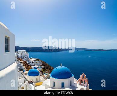 Blue Domes of Oia overlooking the Aegean Sea, Santorini Greece - Stock Photo