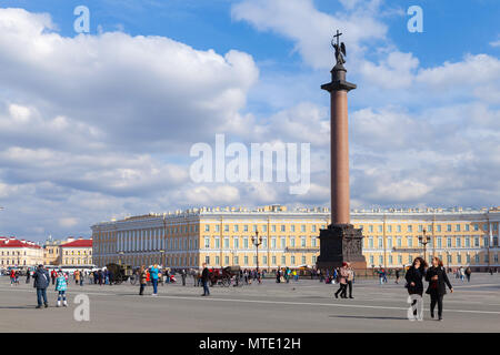 Saint-Petersburg, Russia - April 9, 2016: Ordinary people walk on Palace Square, it is the central city square of St Petersburg and of the former Russ - Stock Photo