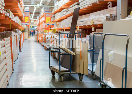 construction cart in the building store. Carts loaded with boards - Stock Photo
