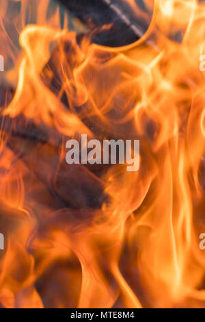 red yellow fire in the fireplace close-up. flames. Fire background. selected focus - Stock Photo