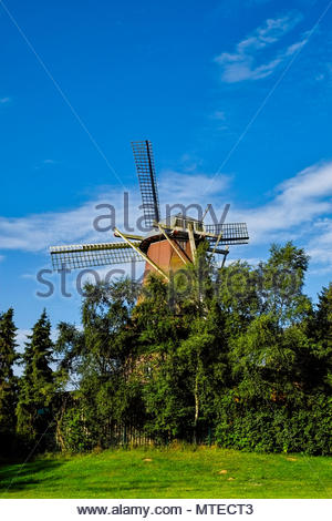 Traditional windmill in Ramsloh, Saterland, Lower Saxony, northern Germany. - Stock Photo