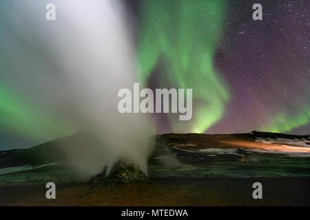 Fumarole, Hverir Geothermal Area, Northern Lights (Aurora borealis), near Mývatn, Northern Iceland, Iceland - Stock Photo