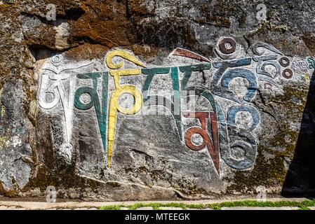 Mural Painting, Buddhist Mantra, Om mani padme hum, Choedrak Monastery at 3800 m, Bumthang, Himalaya, Kingdom of Bhutan - Stock Photo