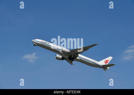 Air China, Boeing, B 777, taking off in front of a blue sky, Munich Airport, Upper Bavaria, Bavaria, Germany - Stock Photo
