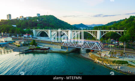 Drone view of the Matsesta viaduct and railway bridge on the background of mountains in summer day, Sochi, Russia - Stock Photo