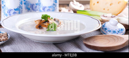 Mushroom cream soup on white wooden board. top view. vegetarian lunch - Stock Photo