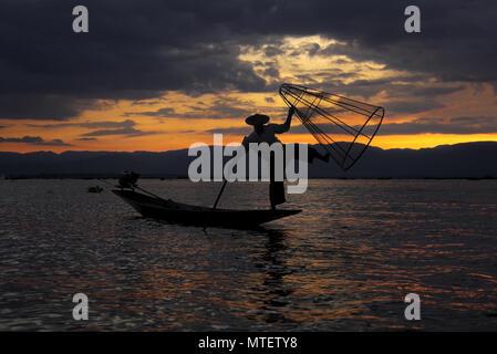 Fisherman of Inle Lake in Myanmar at Sunset - Stock Photo