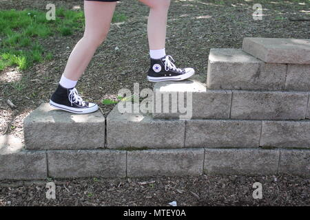 Teenaged girl walking up and down the