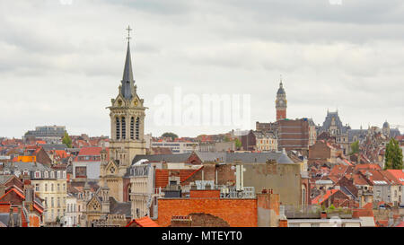Aerial view on Brussels, capital of Belgium and Europe, with houses and church towers - Stock Photo