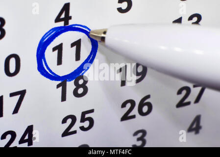 In calendar 11, the number is circled around the blue handle. - Stock Photo