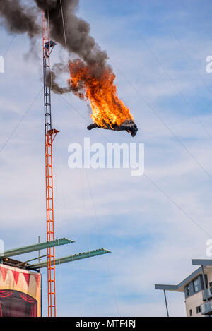 High diving stuntman covered in flames - Stock Photo
