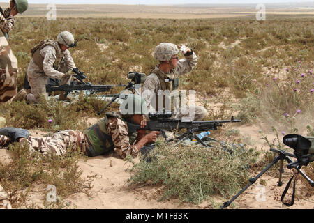 TIFNIT, Morocco - U.S. Marines instruct their counterparts from the Royal Moroccan Armed Forces on proper weapons techniques during Exercise African Lion 2017. African Lion is a combined, multilateral exercise designed to improve interoperability and mutual understanding of each nation's tactics, techniques and procedures while demonstrating the strong bond between the nation's militaries. ( - Stock Photo