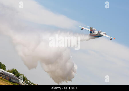 TAGANROG, RUSSIA, MAY 19, 2018: Open Day at the Public Joint Stock Company Beriev Aircraft. Be-200es throws water - Stock Photo
