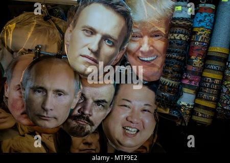 Masks of Vladimir Putin, Alexei Navalny, Vladimir Lenin, Donald Trump, Kim Jong-un lie on the counter of a souvenir stand on Nevsky avenue in St. Pete - Stock Photo