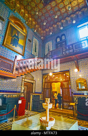 CAIRO, EGYPT - DECEMBER 24, 2017: Picturesque lobby in Residence of Manial Palace with beautiful tilework, carved wooden staircase and ceiling, stone  - Stock Photo