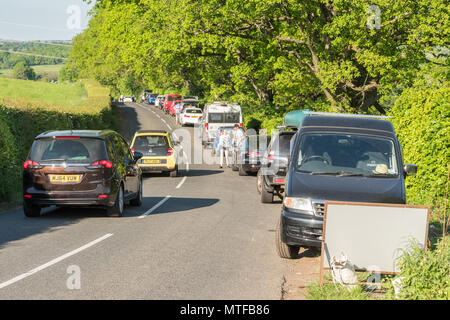 Tourist pressures and car parking problems - cars parked along the B834 road as people visit The Devils Pulpit Finnich Glen, Killearn, Scotland, UK - Stock Photo