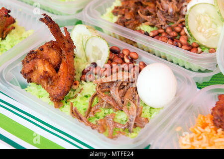 Nasi Lemak is a commonly found food in Malaysia, Brunei and Singapore. It is also an unofficial national food in Malaysia. - Stock Photo