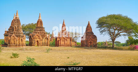 Panorama of the ancient small temples of Bagan, surrounded by greenery and flowers, Myanmar - Stock Photo