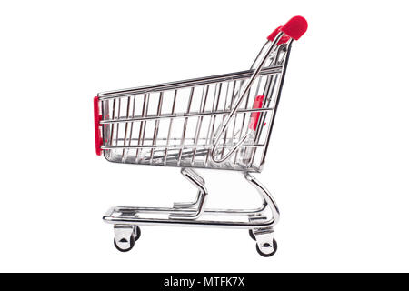 side view closeup of shiny aluminum empty miniature shopping supermarket cart with red handle isolated on white background - Stock Photo